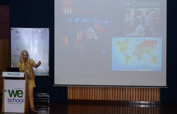 A woman making a presentation. Photo.