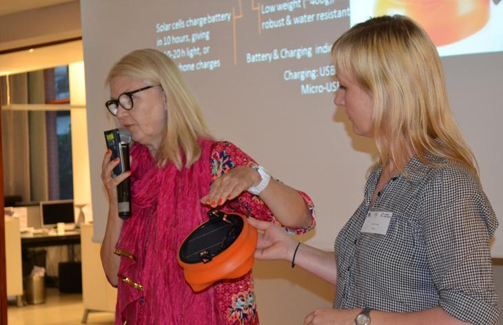Two women making a presentation. Photo.