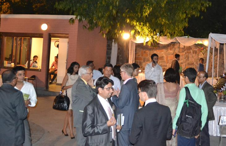 People mingling at night outdoors. Photo.