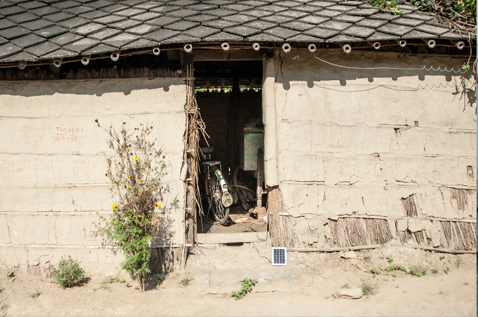 Entrance to a simple house in a rural area. Photo.