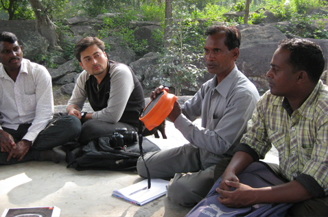 A man demonstrating a product outdoors. Photo.
