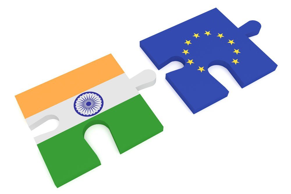 Flags of India and the European Union, depicted as jigsaw puzzle pieces. Illustration.