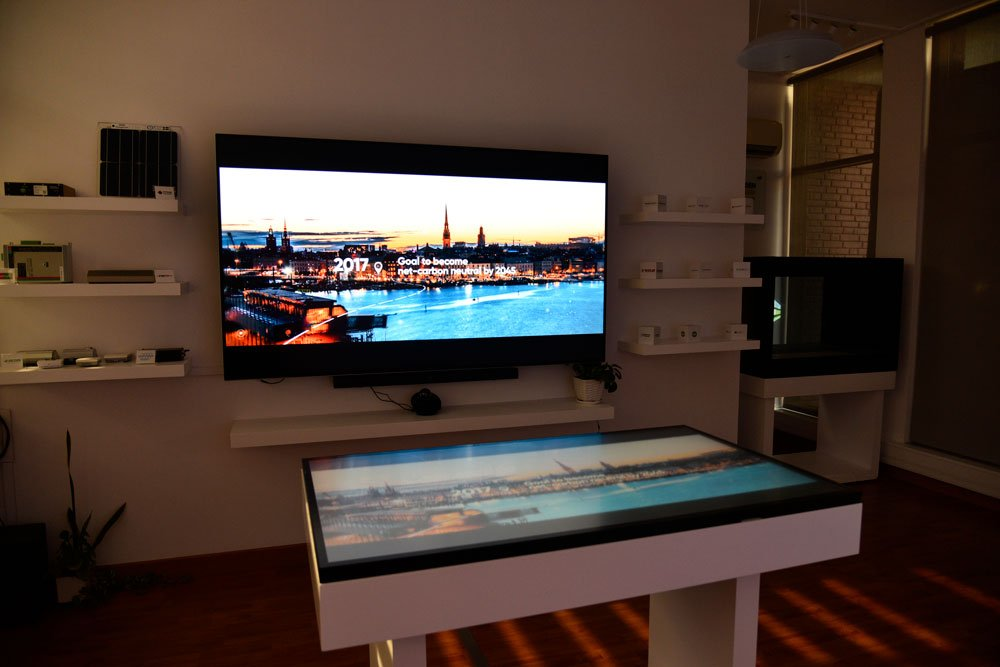 Showroom with a big screen on the wall. Photo.