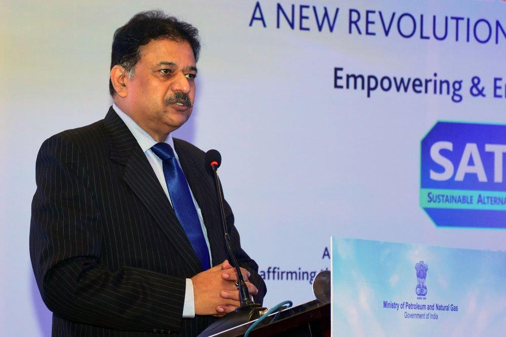 Subodh Kumar speaking into a microphone. Photo.