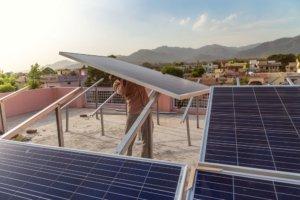 A man installing solar panels. Photo.