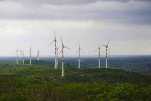 Windmills on green hills. Photo.
